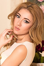 Ukrainian girl Irina,30 years old with brown eyes and blonde hair.