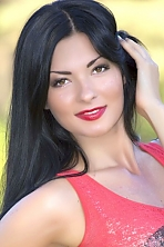 Ukrainian girl Natalia,25 years old with green eyes and black hair.