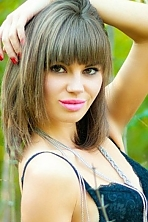 Ukrainian girl Karina,23 years old with brown eyes and dark brown hair.