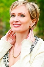 Ukrainian girl Angelina,41 years old with green eyes and light brown hair.