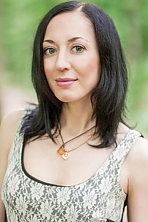 Ukrainian girl Anna,36 years old with green eyes and dark brown hair.