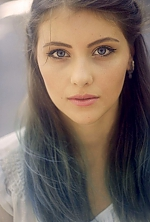 Ukrainian girl Elena,19 years old with blue eyes and light brown hair.