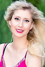 Ukrainian girl Anastasia,29 years old with grey eyes and blonde hair.