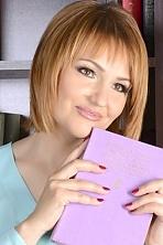 Ukrainian girl Inna,44 years old with hazel eyes and blonde hair.