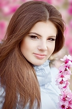 Ukrainian girl Anastasia,23 years old with brown eyes and light brown hair.