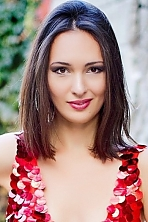 Ukrainian girl Nelly,31 years old with brown eyes and dark brown hair.