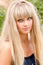 Ukrainian girl Ekaterina,34 years old with green eyes and blonde hair.