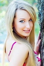 Ukrainian girl Olga,26 years old with grey eyes and blonde hair.