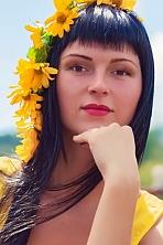 Ukrainian girl Julia,25 years old with brown eyes and black hair.