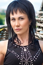 Ukrainian girl Anzhelika,44 years old with black eyes and black hair.