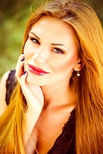 Ukrainian girl Alesya,25 years old with blue eyes and light brown hair.