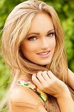 Ukrainian girl Anastasia,19 years old with grey eyes and blonde hair.