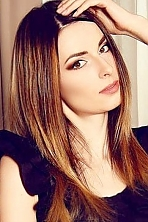 Ukrainian girl Marina,30 years old with brown eyes and dark brown hair.