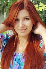 Ukrainian girl Galina,19 years old with green eyes and red hair.