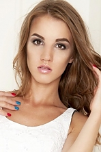 Ukrainian girl Darina,20 years old with brown eyes and light brown hair.