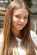 girl Angelina, years old with  eyes and  hair.