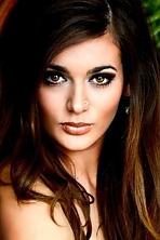 Ukrainian girl Vitalina,21 years old with brown eyes and light brown hair.