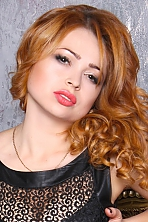 Ukrainian girl Yulia,29 years old with brown eyes and red hair.