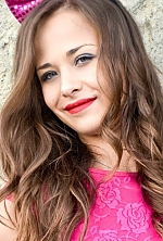 Ukrainian girl Alena,21 years old with green eyes and light brown hair.