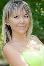 Ukrainian girl Tatiana,38 years old with grey eyes and blonde hair.