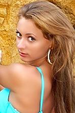 Ukrainian girl Marina,27 years old with hazel eyes and light brown hair.