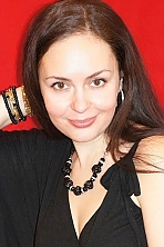 Ukrainian girl Yelyzaveta,34 years old with hazel eyes and dark brown hair.