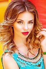 Ukrainian girl Oksana,18 years old with green eyes and light brown hair.