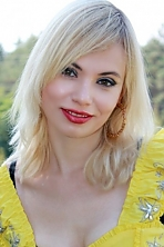 Ukrainian girl Lyudmila,29 years old with green eyes and blonde hair.