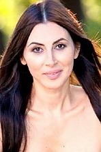 Ukrainian girl Olga,41 years old with brown eyes and dark brown hair.