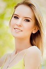Ukrainian girl Alina,21 years old with blue eyes and blonde hair.