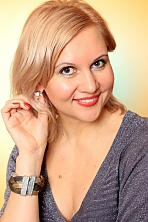 Ukrainian girl Liudmila,41 years old with green eyes and blonde hair.