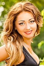 Ukrainian girl Irina,24 years old with grey eyes and blonde hair.
