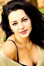 Ukrainian girl Yulia,24 years old with green eyes and dark brown hair.