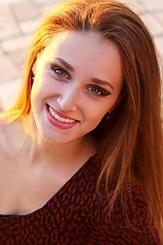Ukrainian girl Mariya,24 years old with green eyes and light brown hair.