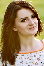 Ukrainian girl Elena,19 years old with brown eyes and black hair.