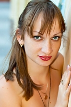 Ukrainian girl Elena,24 years old with grey eyes and light brown hair.