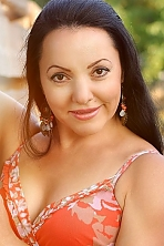Ukrainian girl Ludmila,42 years old with brown eyes and black hair.