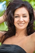 Ukrainian girl Lyudmila,41 years old with green eyes and dark brown hair.