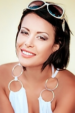 Ukrainian girl Alla,36 years old with grey eyes and black hair.