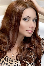 Ukrainian girl Liliya,26 years old with green eyes and light brown hair.