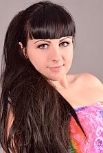 Ukrainian girl Julia,21 years old with green eyes and dark brown hair.
