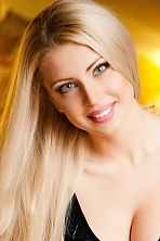 Ukrainian girl Julia,24 years old with green eyes and light brown hair.