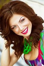 Ukrainian girl Alexandra ,22 years old with green eyes and dark brown hair.