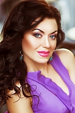 Ukrainian girl Elena ,32 years old with blue eyes and dark brown hair.