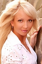 Ukrainian girl Yulia,34 years old with brown eyes and blonde hair.