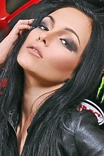 Ukrainian girl Ksenia,22 years old with green eyes and black hair.