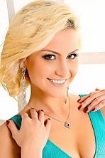 Ukrainian girl Luchiana-Anastasia,26 years old with grey eyes and blonde hair.