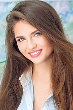 Ukrainian girl Kristina,22 years old with green eyes and light brown hair.