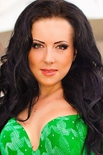 Ukrainian girl Inna,28 years old with green eyes and black hair.