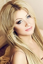 Ukrainian girl Anna,24 years old with blue eyes and blonde hair.